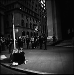 A busker played on the corner of Wall Street opposite the entrance of the New York Stock Exchange at lunchtime. New York City, New York, November 12, 2008