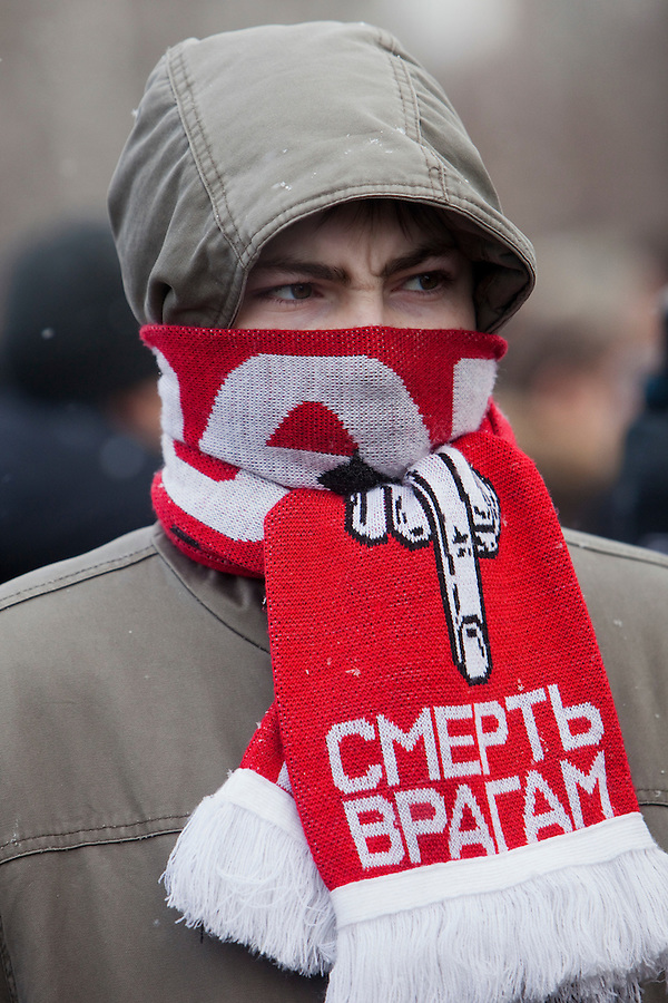 "Moscow, Russia, 15/01/2011..A man wears a Spartak scarf with the words ""Death To The Enemy"" at a rally at the bus stop where Spartak soccer fan Yegor Sviridov was killed in a street fight with a group of men from the southern Caucasus, leading to a nationalist backlash that has spilled into racist violence on the streets of Moscow and other Russian cities. The rally on the 40th day after Sviridov's death was attended by a mixture of local people, football fans and Russian nationalists."