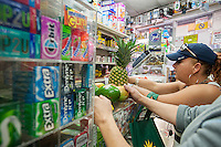"""Customers purchase fresh fruits and vegetables in the Makey Deli in the South Bronx in New York on Thursday, September 19, 2013. A program of City Harvest and Ironwill, """"Healthy Neighborhoods""""  endeavors to improve access to fruits and vegetables in neighborhoods that are """"food deserts"""", providing the primarily low income residents with access to affordable healthy food choices. (© Richard B. Levine)"""