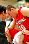 21 January 2010: Stony Brook University Seawolves' guard Bryan Dougher, a Sophomore from Scotch Plains, NJ, gets his knee iced during a game against the University of Vermont Catamounts at Patrick Gymnasium in Burlington, Vermont. The Catamounts fell to the Seawolves 65-60 in the America East matchup. Mandatory Credit: Ed Wolfstein Photo