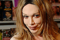 PETE BURNS<br /> (DEAD OR  ALIVE singer)<br /> Promoting his new book &quot;Freak Unique - My Story&quot; at the London Book Fair, Excell Centre, London, England, <br /> March 5th 2006.<br /> portrait headshot plastic surgery lips wig make-up red eyeliner<br /> www.capitalpictures.com<br /> sales@capitalpictures.com<br /> &copy;Phil Loftus/Capital Pictures /MediaPunch ***NORTH AND SOUTH AMERICAS ONLY*** /MediaPunch ***NORTH AND SOUTH AMERICAS ONLY***