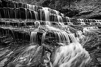 Archangel Falls in black and white lie along the trail to The Subway in Zion National Park and provide a scenic view of cascading water over sandstone.
