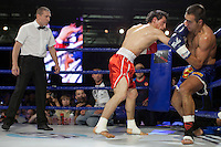 Moscow, Russia, 05/06/2010..Batu Khasikov knocks down Ricardo Fernandes to win a world championship kickboxing bout during the new Fight Nights boxing tournament.
