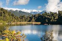 Kayakers on Lake Mapourika near Franz Josef Glacier village, Westland National Park, West Coast, World Heritage Area, New Zealand