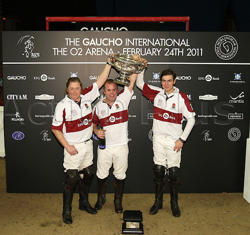 English team photo shoot with the Cup - Max Charlton, Tim Brown and Chirs Hyde at 02 Arena, The Gaucho International Polo 24 February 2011
