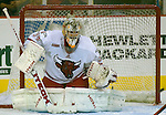 10/10/06 University of Nebraska at Omaha goalie  Jerad Kaufmann eyes a shot during during an exhibition game against Manitoba..(Chris Machian/Prairie Pixel Group)..