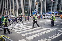 NYPD officers use police tape and barricades to control the hordes of tourists in midtown Manhattan in New York on Sunday, December 22, 2013.  New York is expected to attract 54.3 million tourists in 2013, which is 1.6 million more visitors than 2012. The outgoing Mayor Bloomberg has set a goal of 55 million visitors by 2015. (© Richard B. Levine)