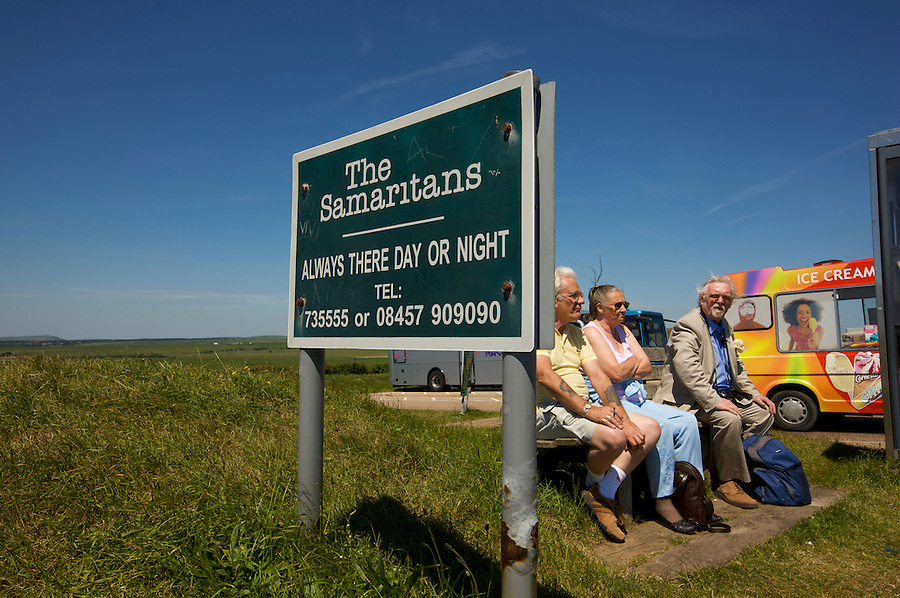 One of the UK's most famous landmarks the cliff face at Beachy Head on the South Downs is also notorious as a suicide spot. Samaritan contact details surround the telephone kiosk and inside to help wouldbe leapers.