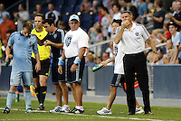 Seth Sinovic (pale blue) gets instructions from Kerry Zavagnin asPeter Vermes (white) tries to get his players attention, Sporting KC... Sporting Kansas City defeated Real Salt Lake 2-0 at LIVESTRONG Sporting Park, Kansas City, Kansas.