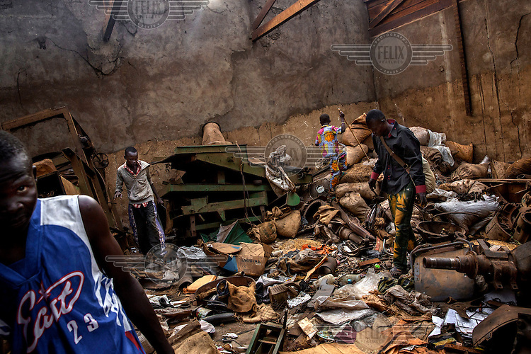 Looters search through a house belonging to a Muslim who fled the city. In 2013 a rebellion by a predominantly Muslim rebel group Seleka, led by Michel Djotodia, toppled the government of President Francios Bozize. Djotodia declared that Seleka would be disbanded but as law and order collapsed the ex-Seleka fighters roamed the country committing atrocities against the civilian population. In response a vigillante group, calling themselves Anti-Balaka (Anti-Machete), sought to defend their lives and property but they then began to take reprisals against the Muslim population and the conflict became increasingly sectarian. French and Chadian peacekeeping forces have struggled to contain the situation and the smaller Muslim population began to flee the country.