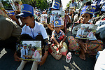 """People participate in a vigil outside a Phnom Penh court on December 14, 2012, during a hearing in which judges denied an appeal by Mam Sonando, a Cambodian radio journalist and human rights activist. Mam Sonando was sentenced in October 2012 to 20 years in prison for """"insurrection,"""" despite local and international calls for his release."""
