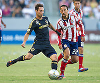 CARSON, CA - July 21, 2012: LA Galaxy midfielder Marcelo Sarvas (8) and Chivas USA defender Ryan Smith (22) during the LA Galaxy vs Chivas USA match at the Home Depot Center in Carson, California. Final score LA Galaxy 3, Chivas USA 1.