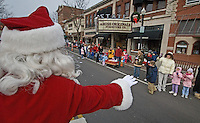 Santa waves to kids and their parents during the Christmas parade in Westerville, Ohio, Sunday, Dec. 3, 2006.<br />