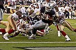Oakland Raiders running back Charlie Garner (25) dives for touchdown on Sunday, November 3, 2002, in Oakland, California. The 49ers defeated the Raiders 23-20 in an overtime game.