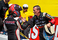 Apr 23, 2017; Baytown, TX, USA; NHRA top fuel driver Steve Torrence (left) is congratulated by Clay Millican during the Springnationals at Royal Purple Raceway. Mandatory Credit: Mark J. Rebilas-USA TODAY Sports