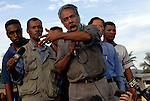 "Escorted by international peacekeepers some 2,000 protesters in trucks, buses and on motorbikes shouted ""bring down Alkatiri"" and voiced support for President Xanana Gusmao as they entered Dili. Gusmao asked them to return to their own places and called for an end to the violence. 060606"