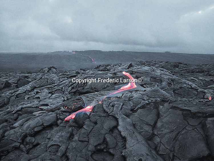 Molten lava streams down live volcano on the big Island of Hawaii.....