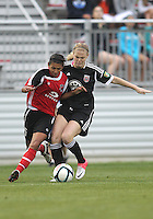 BOYDS, MARYLAND - July 21, 2012:  Samantha Baker (18) of DC United Women tackles Taylor Mertz (5) of the Virginia Beach Piranhas during a W League Eastern Conference Championship semi final match at Maryland Soccerplex, in Boyds, Maryland on July 21. DC United Women won 3-0.