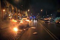 Roma  15 Ottobre 2011.Manifestazione contro la crisi e l'austerità.Scontri tra manifestanti e forze dell'ordine.Cassonetti dati alle fiamme in Piazza Vittorio
