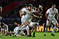 Greg Holmes of Exeter Chiefs fends Luke Wallace of Harlequins. Aviva Premiership match, between Harlequins and Exeter Chiefs on April 14, 2017 at the Twickenham Stoop in London, England. Photo by: Patrick Khachfe / JMP