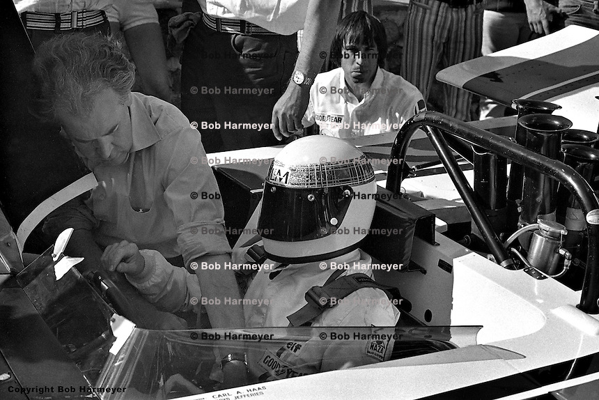 Lola designer Eric Broadley (left) makes final adjustments while Jackie Stewart waits to drive the 1971 L&M Lola Chevrolet SCCA Can-Am car at Le Circuit Mont Tremblant/St. Jovite, Quebec, Canada.