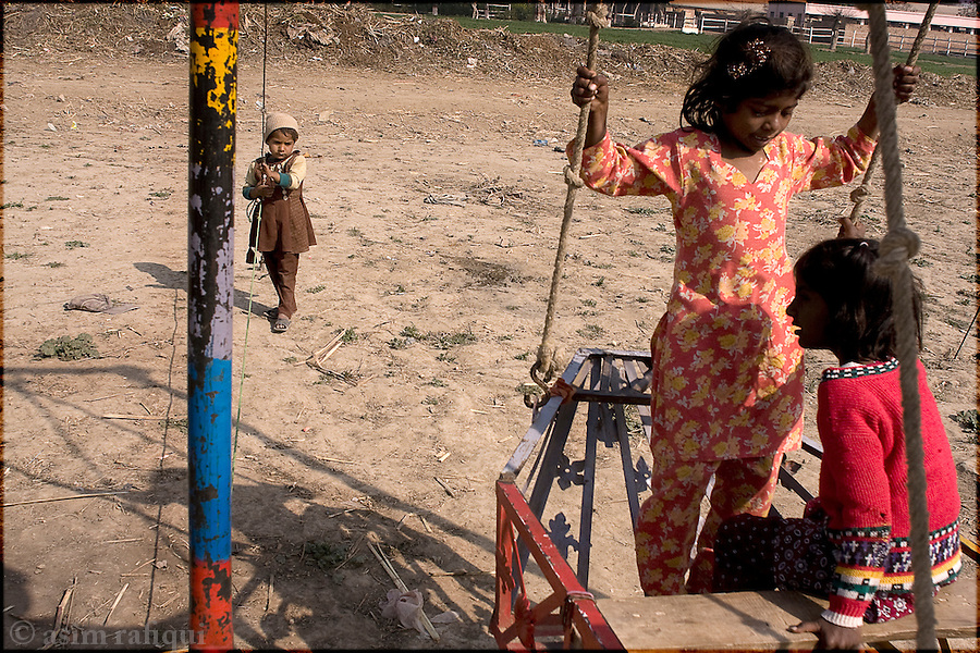 in a village of the landless, children play in a small playground
