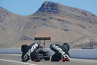 Apr. 3, 2011; Las Vegas, NV, USA: NHRA top fuel dragster driver Terry McMillen slows to a stop with parachutes during the Summitracing.com Nationals at The Strip in Las Vegas. Mandatory Credit: Mark J. Rebilas-