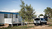 A trailer park, in Garden City, Kansas. This is home to many of the migrant workers who have come to the town to work at the Tyson meat packing plant. The Tyson facility kills and processes between five and six thousand beef cattle every day. Kansas dominates the American beef industry, producing 25% of all beef raised in the USA. However, the industry is heavily dependent on cheap immigrant labour.