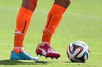 Italy goalkeeper Gianluigi Buffon wearing odd coloured Puma football boots