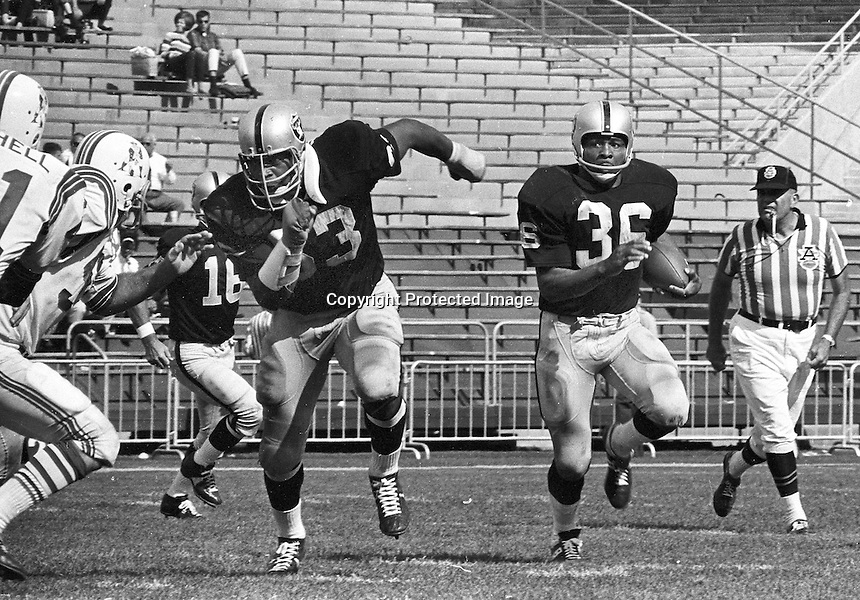 Raider Gene Upshaw blocking for Clem Daniels, 1968. .Photo by Ron Riesterer