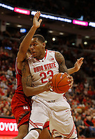 Ohio State Buckeyes center Amir Williams (23) drives against a Nebraska defender in the first half at Value City Arena in Columbus Jan. 4, 2013 (Dispatch photo by Eric Albrecht)