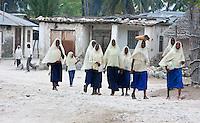 Jambiani, Zanzibar, Tanzania.  Muslim Schoolgirls Walking to School.