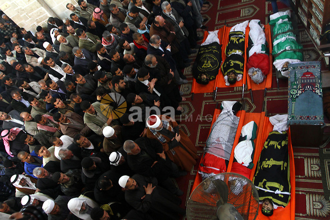 Palestinian mourners attend a funeral at a mosque in Gaza City on March 23, 2011 a day after eight Gazans were killed, among them two minors and four militants, as tensions soared on the border with Israel after days of rocket fire and retaliatory air strikes. Photo by Ashraf Amra