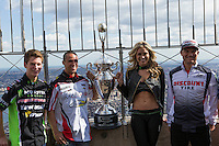 """New York, USA. 23 April 2014.  Supercross motorcycle racers (L-R) Adam Cianciarulo, Mike Alessi, """"Miss Supercross"""" Dianna Dahlgren, Chad Reed promote their motorcycle race during a visit to the Empire State Building in New York. Photo by Eduardo Munoz Alvarez/VIEWpress"""