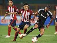 Washington D.C. - July 21, 2014: Davy Arnaud (8) of D.C. United goes against Marky Delgado of Chivas USA.  D.C. United defeated the Chivas USA 3-1 during a Major League Soccer match for the 2014 season at RFK Stadium.