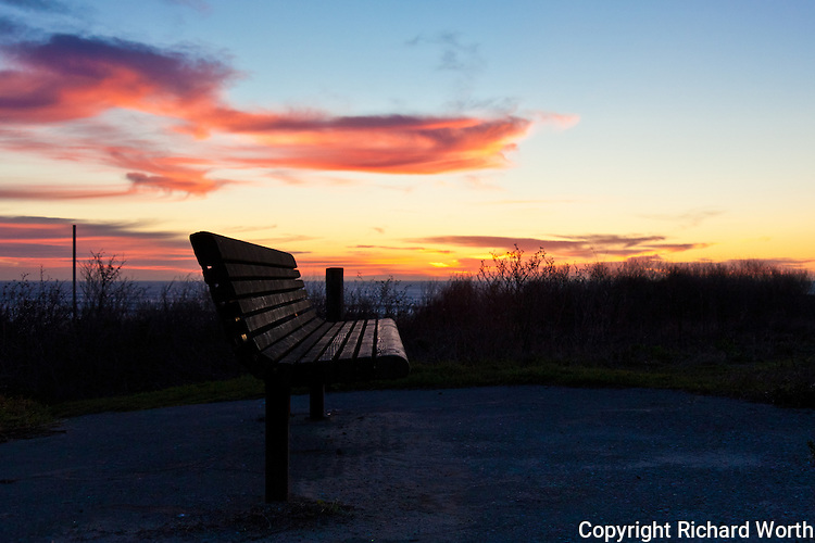A bench along the path at Half Moon Bay's Bluff Top Coastal Park beckons passerby to come, sit, enjoy the sunset.