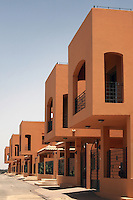 The Al Zawaia Group housing compound in the Soba district of Khartoum, Sudan. New luxury housing projects such as this, containing shops, creches and swimming pools, are springing up all over Khartoum and are sold as quickly as they are built..Khartoum is modeling itself as the Dubai of Africa and despite Western sanctions the city is booming. Away from the troubles and poverty that plaque the rest of Sudan, development in Khartoum is moving at an astonishing rate. Investment from the East, and in particular China, allowed the Sudanese economy to grow by 11% in 2007. This growth is driven largely by oil, with production rising from 63,000 barrels per day in 1999 to over 500,000 barrels today.