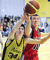 Ian Stewart/Yukon News<br /> Alaska's Austin Osborne and Yukon's Jake Jacobs grab for a loose ball in the gold medal game for junior boys basketball in the Arctic Winter Games on Saturday at FH Collins Secondary School in Whitehorse. Yukon won the match 83-62.