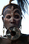 Young woman with lip plate and face painted, Mursi Tribe, Mago National Park, Lower Omo Valley, Ethiopia, portrait, person, one, tribes, tribal, indigenous, peoples, Southern, ethnic, rural, local, traditional, culture, primitive.Africa....