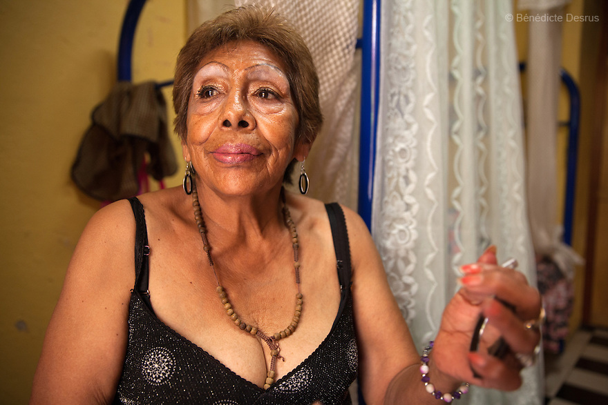 Portrait of Luchita, a resident of Casa Xochiquetzal, at the shelter in Mexico City, Mexico on May 25, 2016. Casa Xochiquetzal is a shelter for elderly sex workers in Mexico City. It gives the women refuge, food, health services, a space to learn about their human rights and courses to help them rediscover their self-confidence and deal with traumatic aspects of their lives. Casa Xochiquetzal provides a space to age with dignity for a group of vulnerable women who are often invisible to society at large. It is the only such shelter existing in Latin America. Photo by Bénédicte Desrus