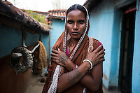 """Shombari Mahato, 36 years old, lives in Dhatkidih. In 2012, when she went to a local pond to wash herself, the other women in the village chased her away, asking her """"How many men have you eaten? Two or three?"""". Few days before, she had been accused by a village widow of trying to kill her daughter. For security reasons, she accepted to be interviewed only far away from her house. The tattoo on her hand represents the symbol of the Adivasi tribe, it states that Adivasi will not take away anything from the earth when they die, except this tattoo, it is their only belonging."""