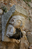 Detail of a corbel with a gargoyle in Monestir de Santes Creus, Aiguamurcia, Catalonia, Spain, pictured on May 21, 2006, in the morning. The Cistercian Reial Monestir Santa Maria de Santes Creus and its church were built between 1174 and 1225. Following strict Cistercian rule, the Romanesque complex originally featured no architectural embellishments with the exception of ornamented capitals and crenellations on the rooflines. In the 13th century parts of the abbey and the cloister were converted in Gothic style by James II of Aragon who also added the dome to the church. Picture by Manuel Cohen.