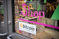 A pop-up store in Midtown Manhattan in New York displays a sign stating that they will accept bitcoins as payment, seen on Thursday, December 19, 2013. As the virtual currency gains in popularity a number of countries, recently China and Denmark, have started to impose regulations on the anonymous, libertarian currency. (© Richard B. levine)