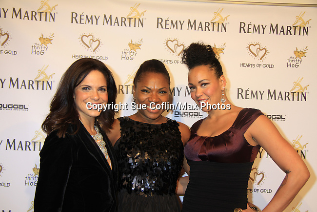 """CNN's Soledad O'Brien (co-mistress of ceremonies) with Deborah Koenigsberger and Maya Azucena at Hearts of Gold's 16th Annual Fall Fundraising Gala & Fashion Show """"Come to the Cabaret"""", a benefit gala for Hearts of Gold on November 16, 2012 at the Metropolitan Pavilion, New York City, New York.   (Photo by Sue Coflin/Max Photos)"""