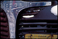 THE BATTERED FRONT END OF A 1940S DODGE FARM TRUCK WITH WISCONSIN FARM LICENSE PLATES.