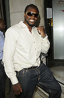 Audley Harrison.The Prince Albert II of Monaco Olympians Reception, Old Burberry Building, Haymarket, London, England..August 9th, 2012.half length sunglasses shades white shirt jeans denim stripe beard facial hair hand fist smiling .CAP/CAN.©Can Nguyen/Capital Pictures.