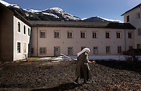 Eleven nuns make their home behind closed walls, living a life of commitment to poverty and celebacy at Val Mustiar, a world-famous Benedictine Convent of St. John.  It is a UNESCO World Heritage Site. The alpine monastery was founded by Charlemagne, was built in the 8th century. Since the 12th century the monastery is run by Benedictine nuns. <br /> <br /> The church houses the world's richest and best preserved series of figuratives Romanesque murals with impressive Carolingian frescos.<br /> <br /> Each nun has her work and they come together for prayer and meals. Monday is laundry day.  Sister Hyacynth helps Sister ... who has worked in the laundry for 20 years.  Sister Mariflora makes fresh juice in the kitchen.  Sister Clara prepares lamb cake for Easter and colors eggs.<br /> The nuns speak a variation of the Romanche language. The dialect changes from valley to valley from Mustair to St. Moritz.