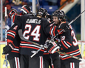The Huskies celebrate McLaughlin's tying goal. - The visiting Northeastern University Huskies defeated the University of Massachusetts-Lowell River Hawks 3-2 with 14 seconds remaining in overtime on Friday, February 11, 2011, at Tsongas Arena in Lowelll, Massachusetts.