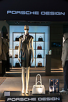 Window display of the Porsche Design shop on corner of Residenzstrasse and Dienerstrasse in Munich, Bavaria, Germany