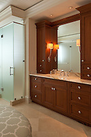 Master Bath has rich stained cabinets in a finish that echoes the wood floors on the level<br /> below